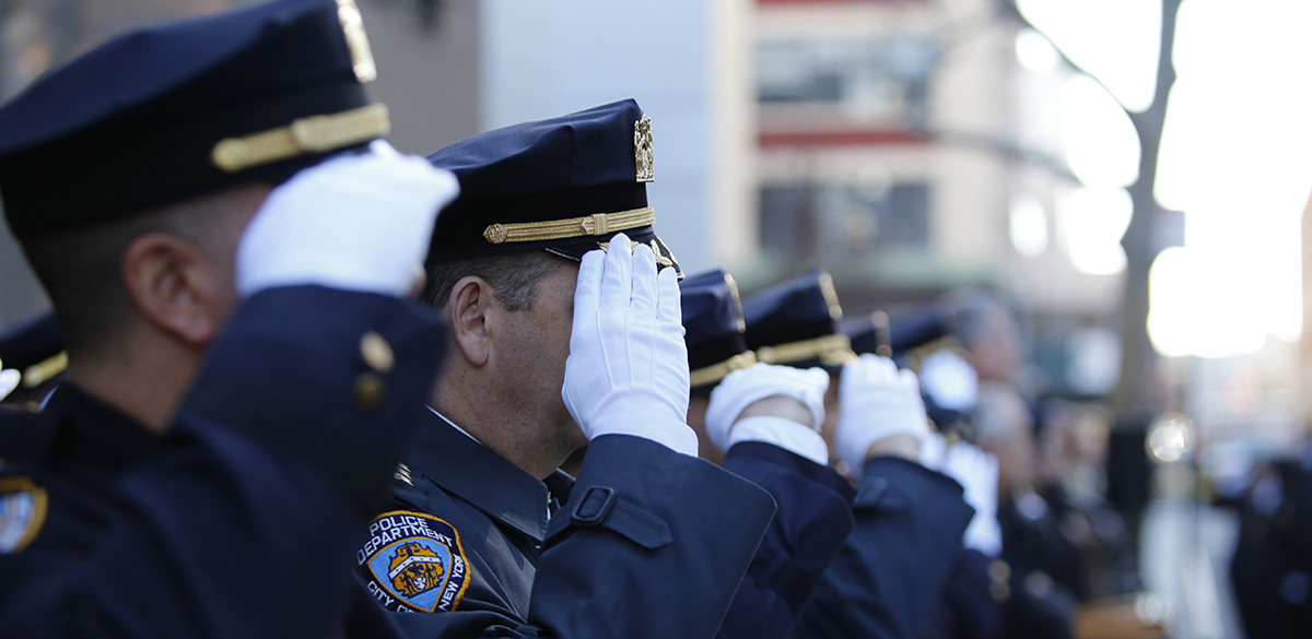 Police officers saluting in dress blues