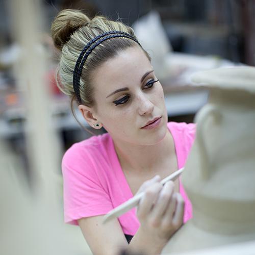 Student in ceramics class