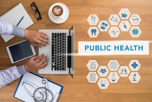 Man with laptop with text public health and various health-related icons