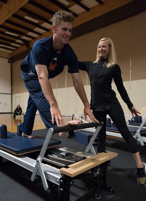 Heidi with student on pilates machine