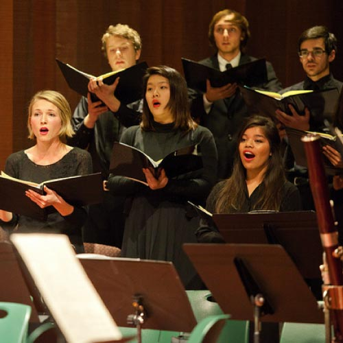Choral students singing during concert