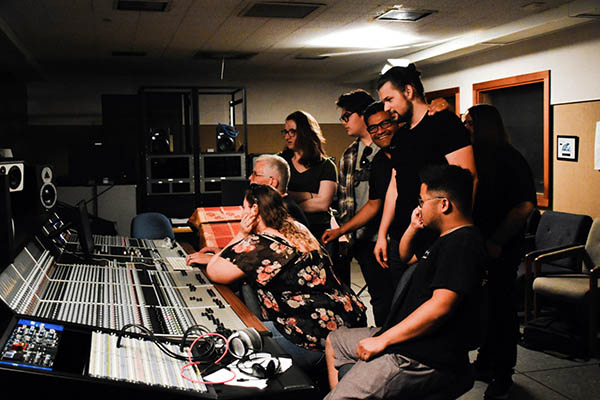 Director of commercial music Jeff Forehan (center) and students working with the new Audient desk at West Valley College.