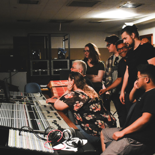 Students in recording studio with instructor