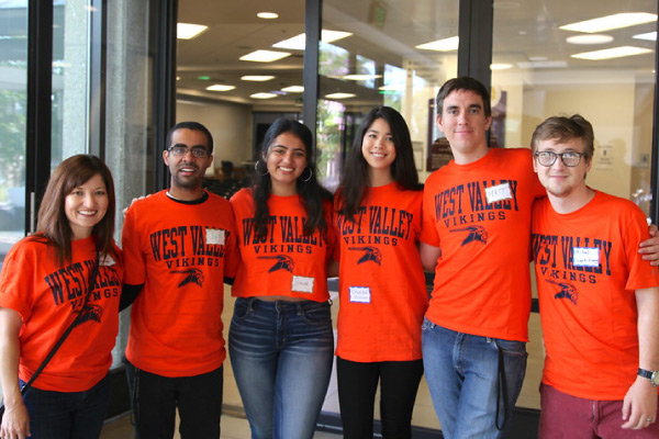 Six diverse students wearing orange West Valley shirts