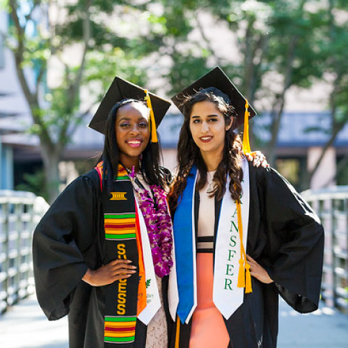 Two female students in graduation garb