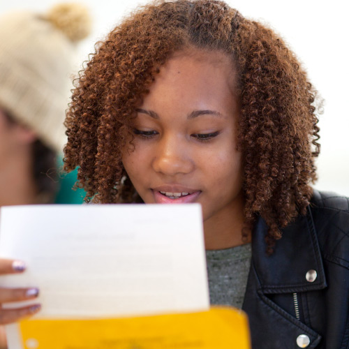 Student looking at paper documents