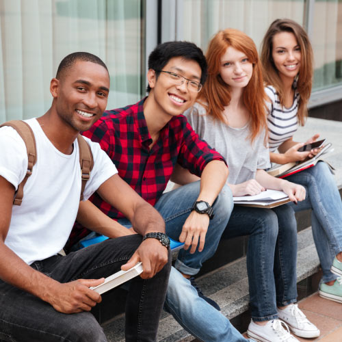 Four diverse students looking at camera