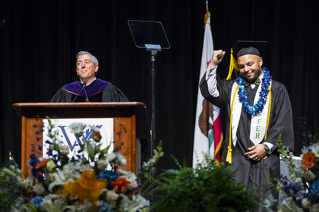 Transfer student on stage with president during graduation ceremony
