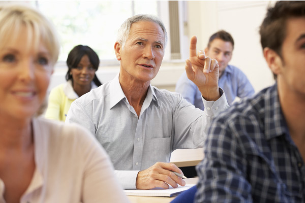 Older student raising finger in class