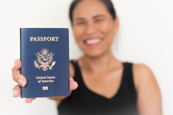 Happy human holding passport