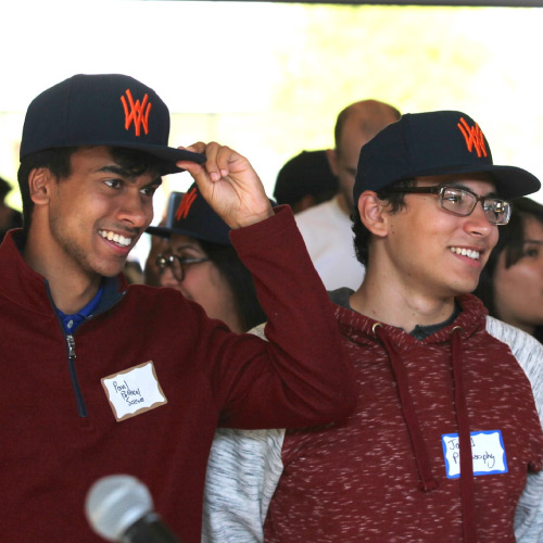 Two students wearing WVC hats