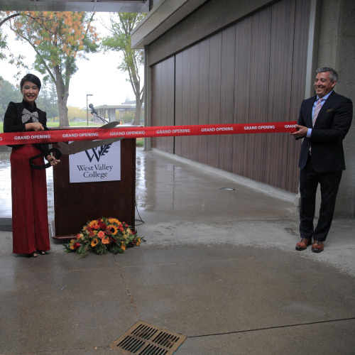 Renee Paquier and Fang Pei Che at building ribbon cutting