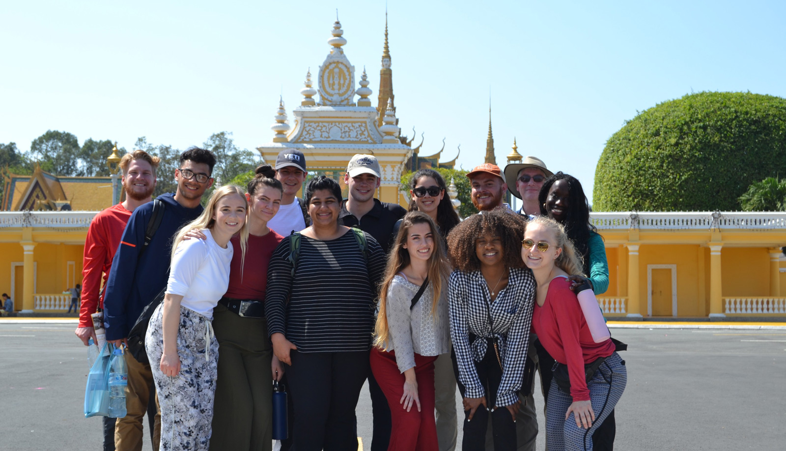 Service Learning students in front of Cambodian palace