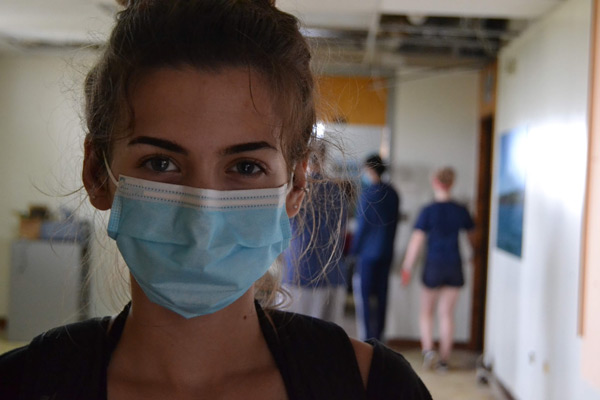 Service Learning student in Puerto Rico with mask